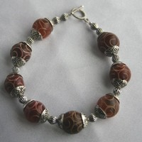Earth Tone Carved Jade & Tibetan Silver Bracelet