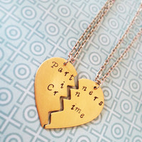 Hand stamped Partners in crime brass necklaces.
