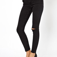 ASOS Low Rise Ultra Skinny Ankle Grazer Jeans in Washed Black with Rip Knee