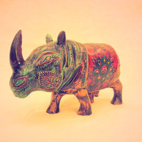 Wooden Rhino painted with Molten Glass