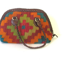 STOREWIDE SALE... vintage KILIM purse. tribal bag. southwestern shoulder purse. carpet bag with braided handles and trim