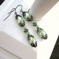 Mint green earrings in pearl oval and gunmetal