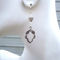 Silver earrings with silver leaflike shaped drops and Austrian crystals