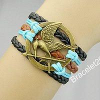 Bracelets,bracelet,Mockingjay bracelet,Mockingjay pin bracelet,catching fire,leather bracelet,hunger bird,Turquoise,couples bracelet,games