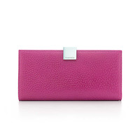 Tiffany & Co. - Continental wallet in orchid textured leather. More colors available.
