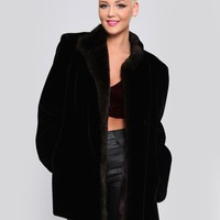 BUNDLED UP FAUX FUR COAT
