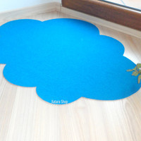 Original rug cloud silhouette. Custom shape carpet. Walking on clouds.