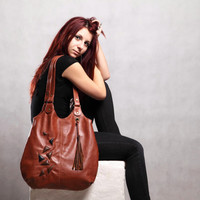 Brown leather bag. Large leather purse with geometric embossed decoration.